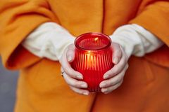 Woman holding burning candle Royalty Free Stock Photos