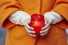 Woman holding burning candle in her hands Stock Photography