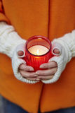 Woman holding burning candle in her hands Royalty Free Stock Photo