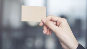 Woman holding the business card Stock Images
