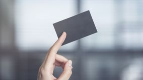 Woman holding the business card Stock Photo