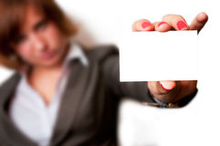 Woman holding business card Stock Images