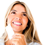 Woman holding a business card Stock Photo