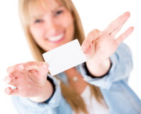 Woman holding a business card Royalty Free Stock Photo