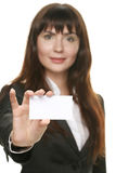 Woman holding a business card and smiling Royalty Free Stock Image