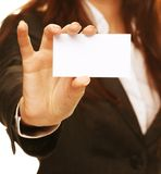 Woman holding a business card and smiling Stock Image