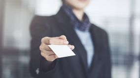 Woman holding the business card Royalty Free Stock Photo