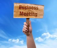 Business meeting wooden sign stock photography