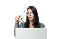 Woman holding Cables in her  hand while Using Laptop Royalty Free Stock Photos