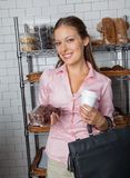 Woman Holding Cake And Coffee Cup At Store Royalty Free Stock Image