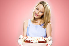 Woman holding cakes Stock Image