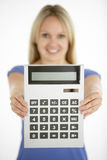 Woman Holding Calculator royalty free stock photography