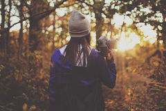 Woman Holding Camcorder in Forest Shooting Sunset Stock Image