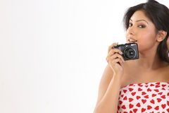 Woman holding a camera stock image