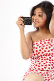 Woman holding a camera Stock Images