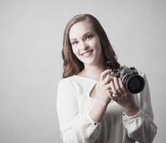 Woman holding antique camera Stock Photography