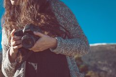 Woman holding camera Stock Images