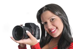 Woman holding camera in hand t Royalty Free Stock Images