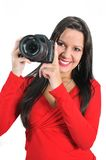 Woman holding camera in hand t Stock Photo