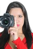 Woman holding camera in hand t Royalty Free Stock Photography