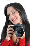 Woman holding camera in hand t Stock Photos