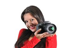 Woman holding camera in hand t Stock Photography