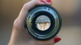 Woman holding camera lens, professional photo equipment, modern technology. Stock footage stock video footage