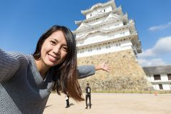 Woman holding camera to take photo with Himeji castle Stock Photo
