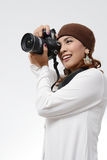 Woman holding camera Royalty Free Stock Image