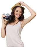 Woman holding camera. Young pretty woman holding camera Stock Photo