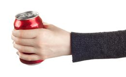 Female hand holding closed can of soda. Woman holding a can of soda Stock Photography