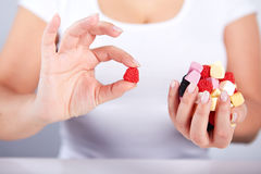 Woman holding a candies Royalty Free Stock Photography