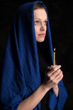 Woman holding candle and praying Royalty Free Stock Photo
