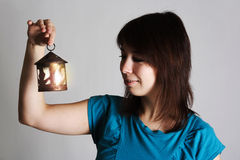 Woman holding candlestick with burning candle Royalty Free Stock Photography