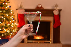 Woman holding candy cane martini Stock Photos