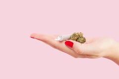 Woman holding cannabis bud. Stock Photography