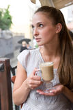 Woman is holding cappuccino Royalty Free Stock Image
