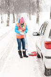 Woman holding car chains winter tire snow. Woman holding tire chains car snow broken problems winter young Royalty Free Stock Photo