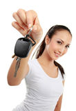Woman holding car key Stock Photo
