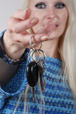 Woman holding car key Royalty Free Stock Images