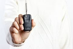 woman holding a car key on white backgrounds royalty free stock images