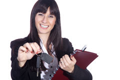 Woman holding car keys and contract Stock Photo