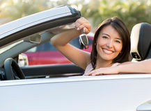 Woman holding car keys Stock Photos