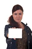 Woman holding card. Woman holding a blank card with space for your text. Focus on hand/card Royalty Free Stock Photo