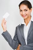 Woman holding a card Royalty Free Stock Photography