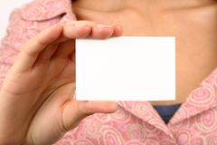 Woman holding card. Young woman holding an empty business card. Insert your own text. Focus on card Royalty Free Stock Image