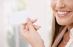 Woman holding card Stock Photography