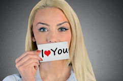 Woman holding card with I love you word Royalty Free Stock Photos