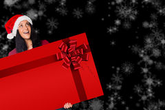 Woman holding a card with red christmas ribbon Stock Images