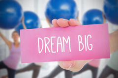 Woman holding card saying dream big Royalty Free Stock Photography